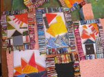 The mosaics inside our rolled magazine projects. House, boat on the sea, city with hearts in the sky